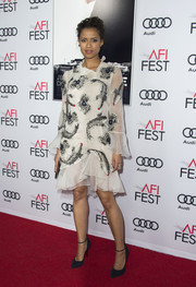 Gugu Mbatha-Raw chose a beaded white Erdem frock with a ruffle hem and cuffs for the AFI Fest premiere of 'Miss Sloane.'