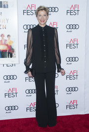 Annette Bening matched her top with a pair of black bell-bottoms.