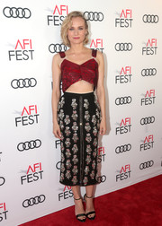 Diane Kruger displayed her flat abs in a cherry-red crop-top by Nº21 at the AFI FEST screening of 'Guess Who's Coming to Dinner.'