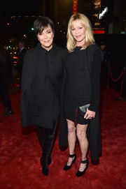 Melanie Griffith topped off her dress with a long black cardigan.