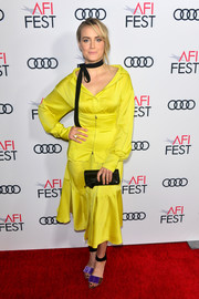 Taylor Schilling styled her frock with a pair of tricolor velvet sandals by Pierre Hardy.