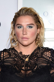 Kesha attended the AFI FEST premiere of 'On the Basis of Sex' wearing a messy wavy hairstyle.