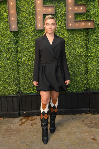 Florence Pugh punched up her look with a pair of harlequin-patterned boots, also by Ferragamo.