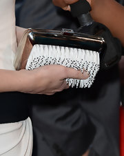 Cate kept her evening accessories to a minimum with this unique metallic clutch.