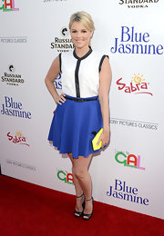 Ali had fun with color-blocking when she donned this sleeveless black-and-white blouse with a colorful purple top.