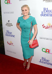 Amanda Michalka showed off her hourglass figure in this teal retro-inspired, below-the-knee dress that featured a wide Puritan-style collar and bold teal buttons.