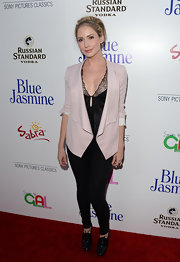 Ashley's soft pink blazer added some feminine color to her all-black look on the red carpet.