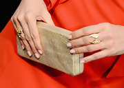 Jodi stuck to a neutral clutch to let her vibrant orange dress take all the attention!