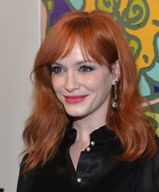 Christina Hendricks left her hair loose with gentle waves and wispy bangs when she attended the 'Mad Men' season 7 premiere.