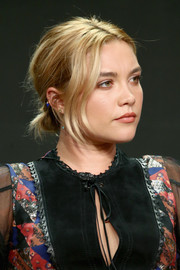 Florence Pugh wore her hair in a casual chignon at the Summer 2018 TCA Press Tour.