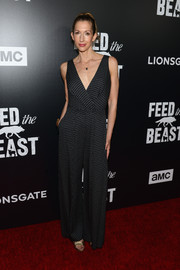 Alysia Reiner was casual-chic in a dotted, wrap-bodice jumpsuit while attending the premiere of 'Feed the Beast.'