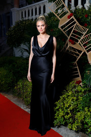Kate Upton was the picture of elegance in a black satin gown with a draped bodice at the Amore cocktail reception.