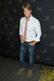 Eric Stromer chose a pair of distressed skinny jeans to complete his stylish evening look.