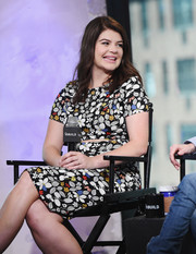 Casey Wilson looked trendy on AOL Build in a floral dress with a slash along the midsection.