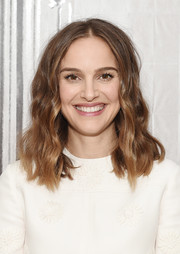Natalie Portman looked oh-so-sweet with her center-parted waves while visiting AOL Build.