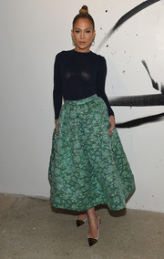 Jennifer Lopez donned a tight-fitting navy sweater by Christian Siriano for the AOL Build Speaker Series.