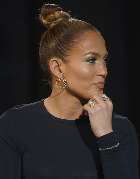 Jennifer Lopez pulled her hair up into a tight, trendy top knot for the AOL Build Speaker Series.