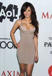 Melanie showed off her assets in a slim fitting nude cocktail dress at the Maxim party.