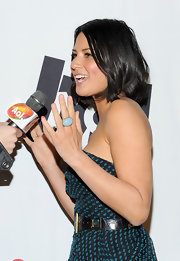 Olivia Munn paired her geometric print dress with a turqouise cocktail ring.