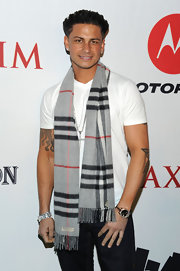 Paul added a nice flair to his plain white-t with a gray patterned scarf.