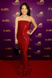 Zhang Ziyi looked modern on the red carpet in a strapless red peplum dress by Armani Prive at the APAC Film Festival.