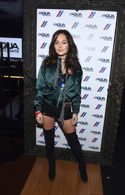 Kelli Berglund went for a bold finish with a pair of black thigh-high boots.