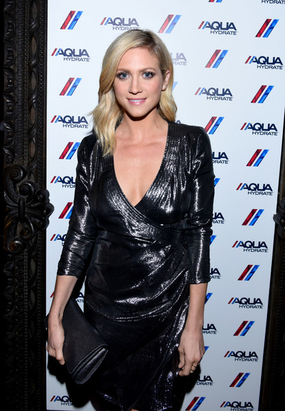 Brittany Snow matched a black leather clutch with a shiny wrap dress for the AQUAhydrate private event.