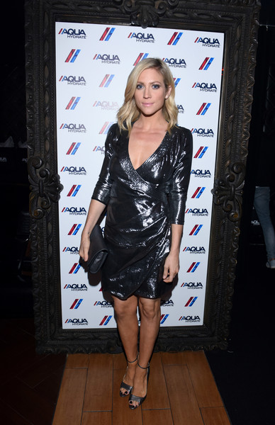Brittany Snow attended the AQUAhydrate private event rocking a shiny black wrap dress.