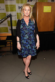 Kathy Hilton attended Aruba in Style wearing a printed wrap dress.