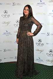 Sabine looked majestic in this feather print gown at the holiday gala dinner.