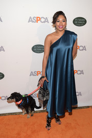 Alicia Quarles went for an edgy finish with a pair of black patent gladiator heels.