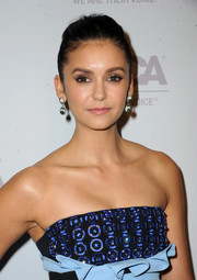 Nina Dobrev sported a pompadour ponytail at the ASPCA Los Angeles benefit.