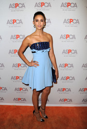 Nina Dobrev was edgy-chic in a David Koma strapless dress, in two shades of blue with a metallic bustline, during the ASPCA Los Angeles benefit.
