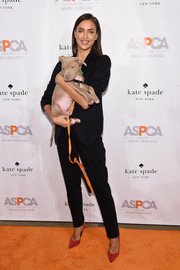 Irina Shayk looked seriously stylish in a black pantsuit while attending the ASPCA Young Friends benefit.