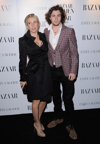 Aaron Johnson Walking Shoes [fashion,suit,event,fashion design,dress,premiere,formal wear,white-collar worker,little black dress,style,arrivals,harpers bazaar women of the year awards,aaron johnson,sam taylor-wood,harpers bazaar women of the year awards,england,london]