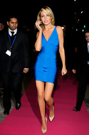 Abbey Clancy donned a shining blue bandage dress for a red carpet launch in London.