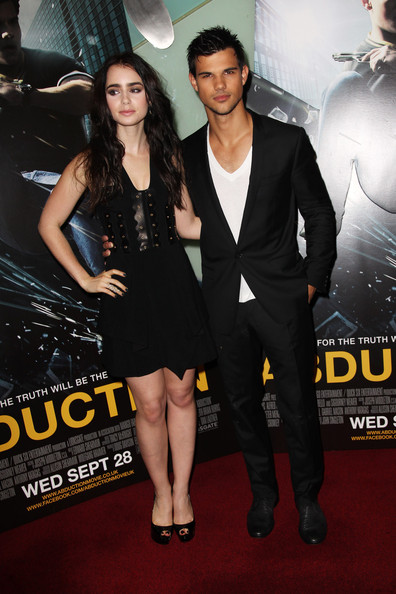 Taylor Lautner looked stylish and polished at the 'Abduction' premiere in London. He opted for a classic black suit paired with a white V-neck tee.