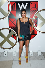 Alicia Quarles sealed off her look with a stylish jewel-toned box clutch.