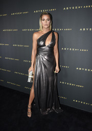 Khloe Kardashian looked ravishing in a gunmetal one-shoulder cutout gown at the Abyss by Abby Arabian Nights collection launch.