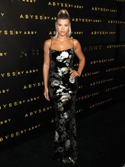 Sofia Richie turned heads in a fitted floral slip gown at the Abyss by Abby launch.