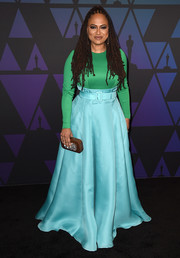 Ava DuVernay attended the 2018 Governors Awards wearing a fitted emerald blouse by Prada.