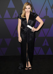Chloe Grace Moretz complemented her dress with black ankle-strap sandals, also by Louis Vuitton.