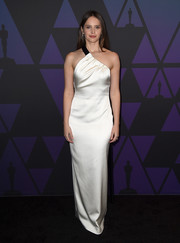 Felicity Jones looked simply elegant in a white satin one-shoulder gown by Miu Miu at the 2018 Governors Awards.