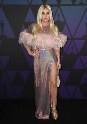 Kesha looked radiant in an iridescent sequined and feathered gown by Cheng at the 2018 Governors Awards.