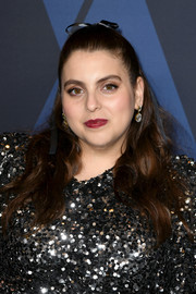 Beanie Feldstein chose a classic red hue for her lips.