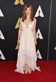 Jessica Chastain looked angelic at the Governors Awards in an ivory Nina Ricci fishtail gown with a tiered skirt and a lacy yoke.