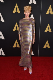 Tilda Swinton made a head-turning entrance at the Governors Awards in a fully sequined, multicolored striped gown by Schiaparelli Couture.