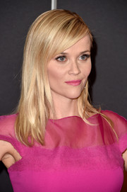 Reese Witherspoon was Elle Woods all over again with this pink lipstick and dress combo.