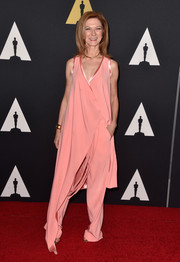 Dawn Hudson looked ultra modern in her asymmetrical pink wrap-top and slacks ensemble at the Governors Awards.
