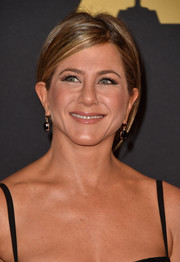 Jennifer Aniston sealed off her look with a pair of dangling onyx earrings by Irene Neuwirth.